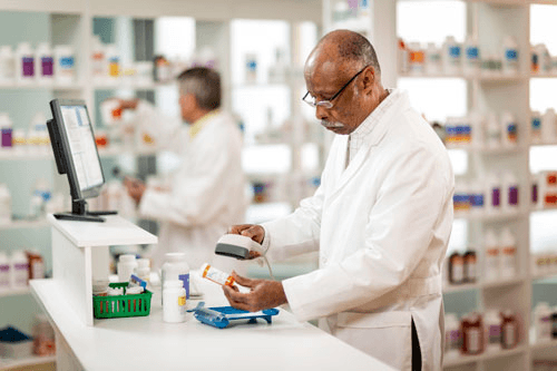 Photo of a pharmacy using the Net Rx system in running their operations